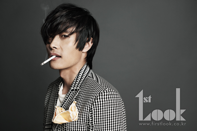 Lee Byung-hun smoking a cigarette (or weed)